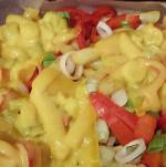 Patate peperonate con un tocco di formaggio e curry