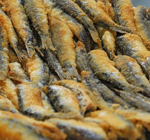 Alici ripiene con mozzarella e pezzetti di oliva